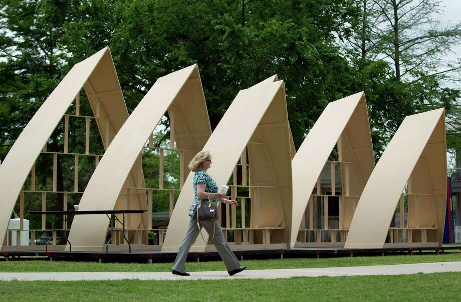 A likeness of Australia's Sydney Opera House takes shape Thursday in Sam Houston Park amid preparations for this year's iFest. Photo: Johnny Hanson / © 2014  Houston Chronicle