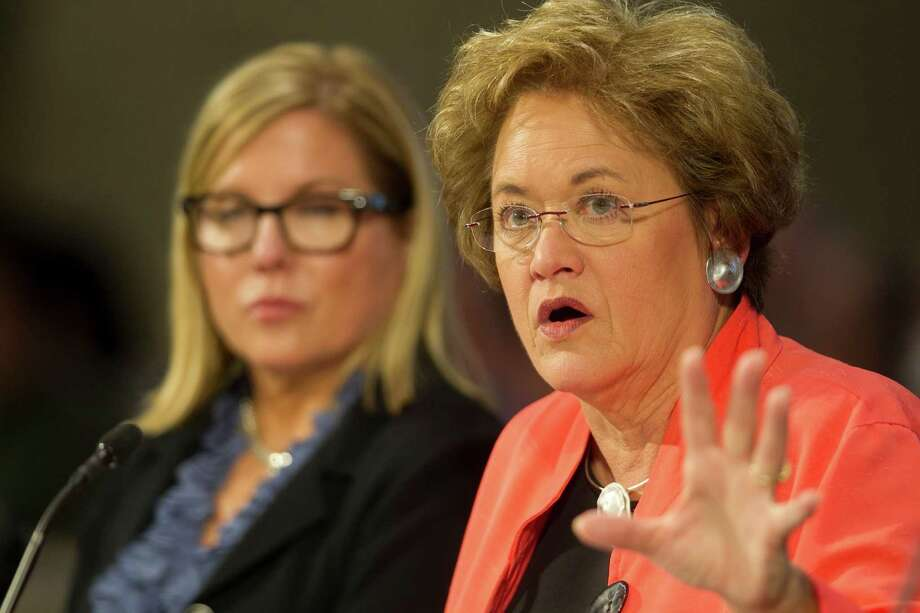 Travis County District Attorney Rosemary Lehmberg, right, was arrested for drunken driving in April 2013. When she refused to step down, Gov. Perry vetoed funds for the Public Intergity Unit. Photo: Jay Janner / Austin American-Statesman