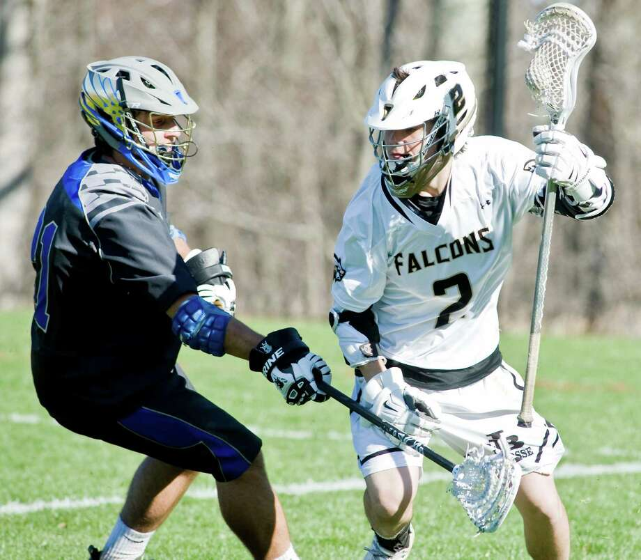 Newtown High School's Doug Miller tries to block Joel Barlow High School's Connor Martin during a game at Joel Barlow. Thursday, April 24, 2014 Photo: Scott Mullin / The News-Times Freelance