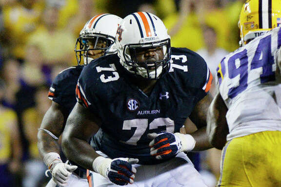 Auburn offensive lineman Greg Robinson could be drafted as high as No. 2 by St. Louis.