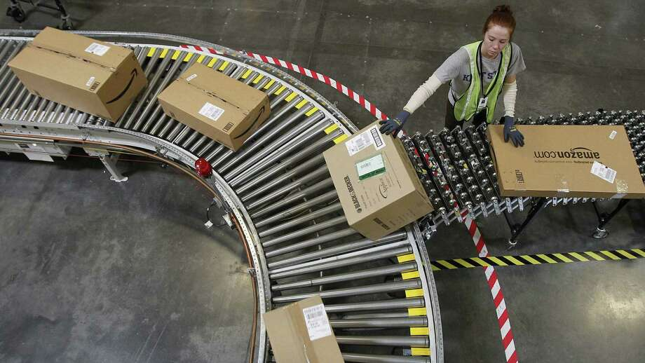 Katherine Braun sorts packages at an Amazon.com fulfillment center in Goodyear, Ariz., in 2010. Ohio State University researchers found that households in states with an online sales tax reduced their Amazon spending. Photo: Photos By Ross D. Franklin / Associated Press / AP