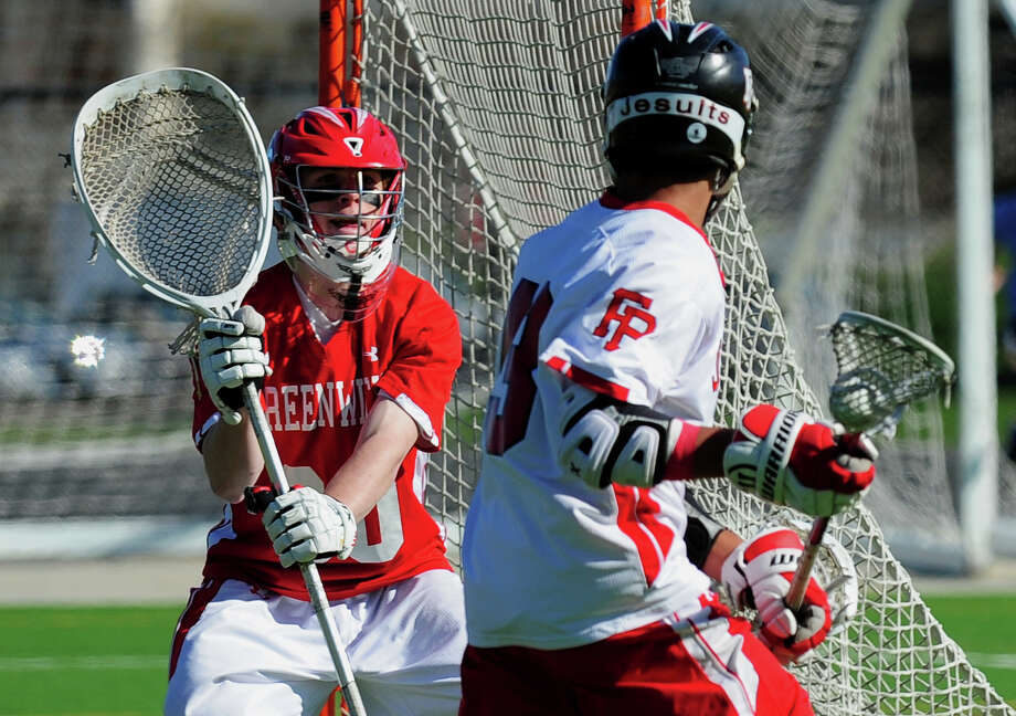Greenwich goalie Tommy Rogan stands ready as Fairfield Prep's Cam Harris goes past, during boys lacrosse action at Fairfield University in Fairfield, Conn. on Thursday April 24, 2014. Photo: Christian Abraham / Connecticut Post