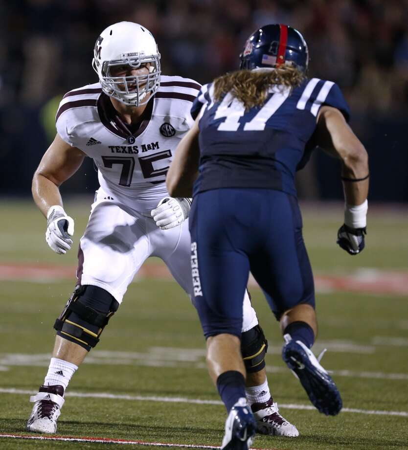Jake Matthews, T, 6-5 ¾, 308, 5.07, Texas A&MA four-year starter, including his first three seasons on the right side and last season on the left side. He had to protect Johnny Manziel's blind side. He's smart, plays sound technique, doesn't make many mistakes, drops well and knows how to redirect. Photo: Rogelio V. Solis, Associated Press