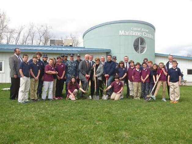 Elected and local chamber officials, Boy Scouts, Navy Operational Support Center sailors and Capital Region Maritime Center administrators and students commemorated Earth Week by planting saplings as part of the Department of Environmental Conservation?s Trees for Tribs program on Wednesday. Nearly 100 trees are to be planted at the Maritime Center as part of the program.