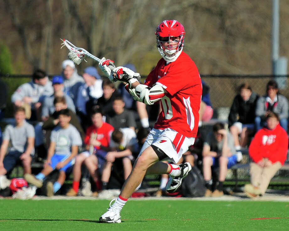 Greenwich's  Will Perry attepts a goal shot, during boys lacrosse action against Fairfield Prep at Fairfield University in Fairfield, Conn. on Thursday April 24, 2014. Photo: Christian Abraham / Connecticut Post