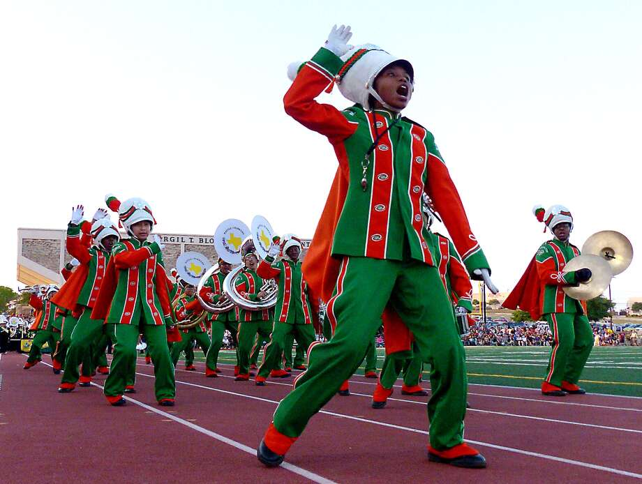 "Drum major Krystalin Jones of Houston High School leads her band during the 76th Battle of Flowers Association Band Festival at Comalander Stadium on Thursday, April 24, 2014. The theme of the event was ""The Magic of Make Believe"" and more than 30 high school bands participated. Photo: Billy Calzada, San Antonio Express-News /  San Antonio Express-News"