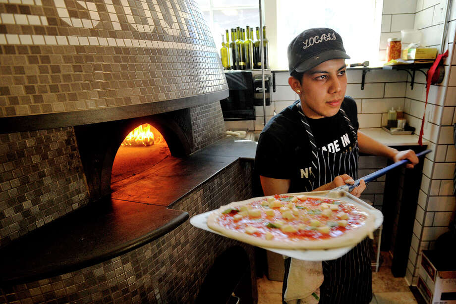 Pizzialo, or pizza chef, Danny Castro prepares to bake a pizza in a handmade Stefano Ferrara wood-fired oven at Locali Pizza Bar & Kitchen in New Canaan, Conn. Photographed on Thursday, April 24, 2014. Photo: Jason Rearick / Stamford Advocate