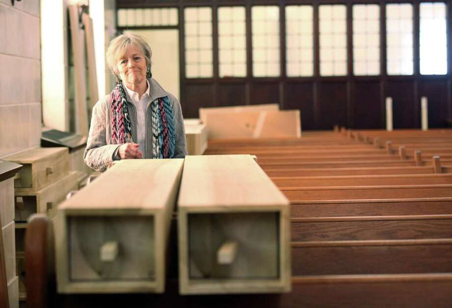 Dorry Shaddock, organist at First Evangelical Lutheran Church, admires the giant pipes of the new pipe organ to replace the one that was damaged in a fire on March 10, 2014, in Houston. The assembly of the organ will take a week, then the tuning will take 3 weeks. Photo: Mayra Beltran, Houston Chronicle / © 2014 Houston Chronicle