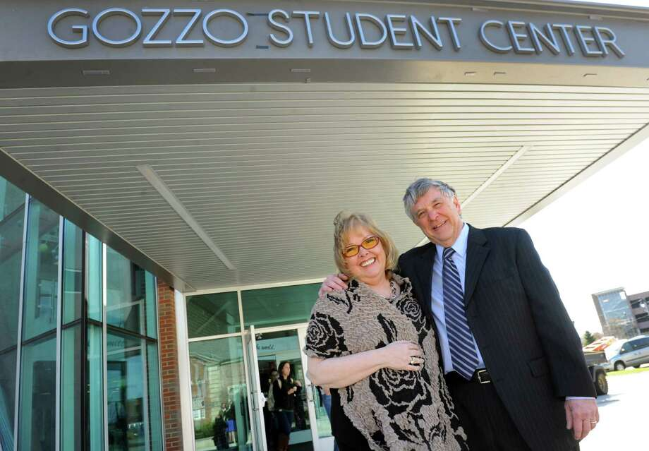 Lorraine Gozzo, left, and her husband, college president James Gozzo, stand by the Gozzo Student Center, named in his honor, on Thursday, April 24, 2014, at the Albany College of Pharmacy and Health Sciences in Albany, N.Y. (Cindy Schultz / Times Union) Photo: Cindy Schultz / 00026594A