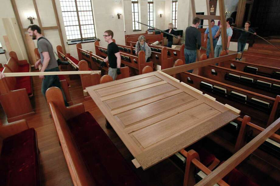 The panel of the new pipe organ is set on the church pews as volunteers quickly unload pieces of the pipe organ to assemble at First Evangelical Lutheran Church in downtown on March 10, 2014, in Houston. The assembly of the organ will take a week, then the tuning will take 3 weeks. Photo: Mayra Beltran, Houston Chronicle / © 2014 Houston Chronicle