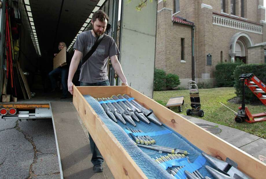 The Rev. Evan McClanahan, STS, helps carry pieces of the new pipe organ into First Evangelical Lutheran Church in downtown is getting on March 10, 2014, in Houston. The assembly of the organ will take a week, then the tuning will take 3 weeks. Photo: Mayra Beltran, Houston Chronicle / © 2014 Houston Chronicle