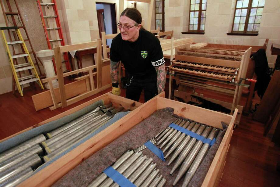 Markus Morscher sets down pieces of the new pipe organ to replace the one that was damaged in a fire at First Evangelical Lutheran Church in downtown on March 10, 2014, in Houston. Photo: Mayra Beltran, Houston Chronicle / © 2014 Houston Chronicle
