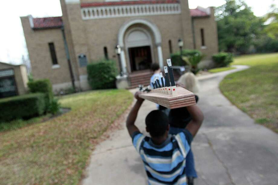 Volunteers carry pieces of a new pipe organ to replace the one that was damaged in a fire at First Evangelical Lutheran Church in downtown on March 10, 2014, in Houston. Photo: Mayra Beltran, Houston Chronicle / © 2014 Houston Chronicle
