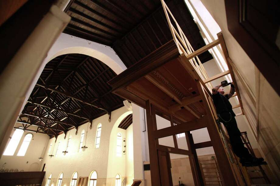 Markus Morscher, of Pasi Organ Builders, begin to build the frame of the new pipe organ which will be assembled at First Evangelical Lutheran Church on March 11, 2014, in Houston. Photo: Mayra Beltran, Houston Chronicle / © 2014 Houston Chronicle
