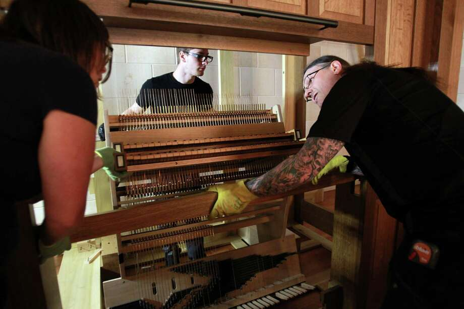 Steven Jett and Markus Morscher set the pipe organ console in place at First Evangelical Lutheran Church on March 14, 2014, in Houston. Photo: Mayra Beltran, Houston Chronicle / © 2014 Houston Chronicle