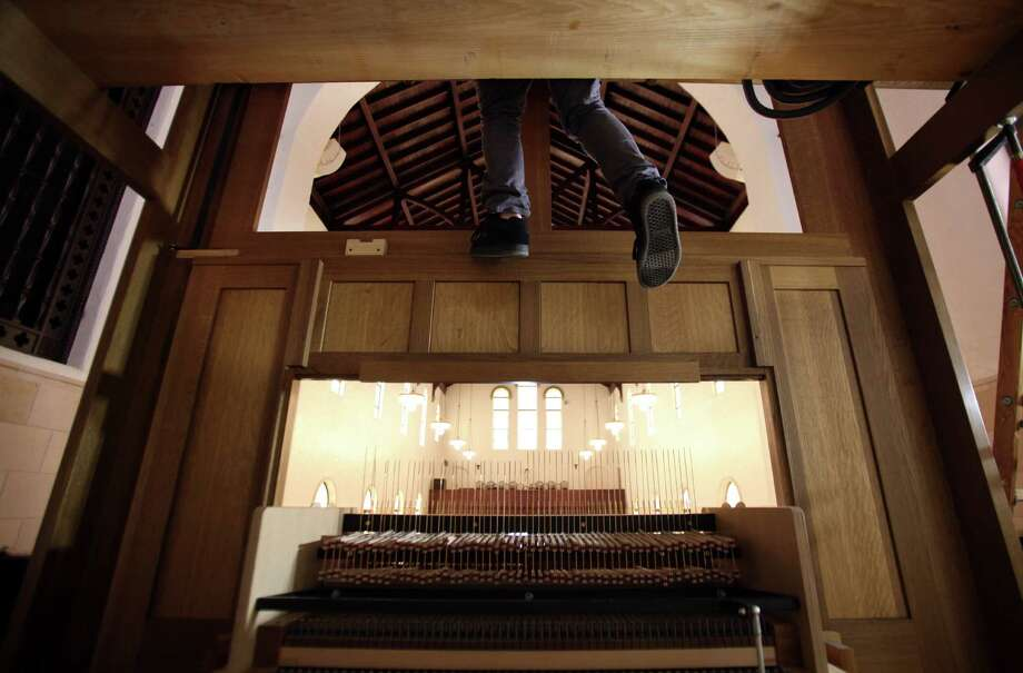 Steven Jett, of Pasi Organ Builders, connects pipes above the pipe console as they assemble the new pipe organ at First Evangelical Lutheran Church on March 14, 2014, in Houston. Photo: Mayra Beltran, Houston Chronicle / © 2014 Houston Chronicle