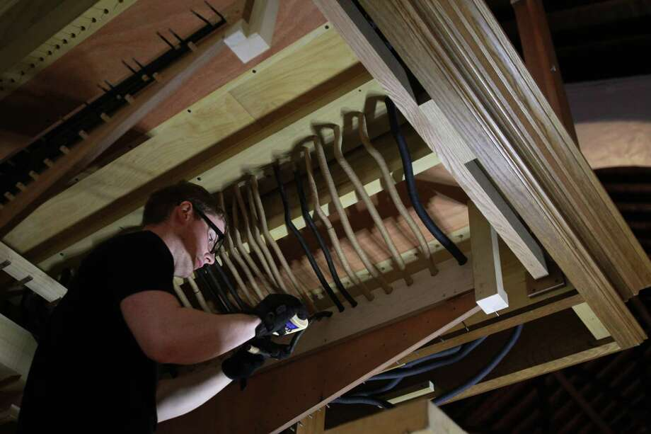 Steven Jett, of Pasi Organ Builders, connects pipes above the pipe organ console as they assemble the new pipe organ at First Evangelical Lutheran Church on March 14, 2014, in Houston. Photo: Mayra Beltran, Houston Chronicle / © 2014 Houston Chronicle