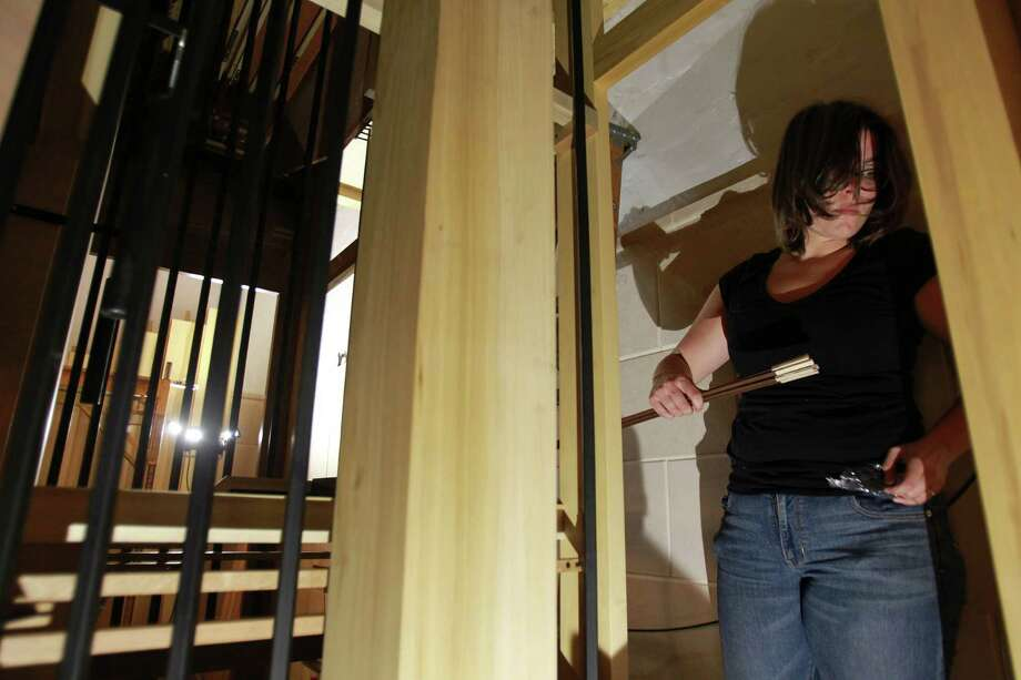Maurine Pasi sets trackers from the keyboard to the pipes as the Pasi Organ Builders team assemble the new pipe organ at First Evangelical Lutheran Church on March 19, 2014, in Houston. Photo: Mayra Beltran, Houston Chronicle / © 2014 Houston Chronicle