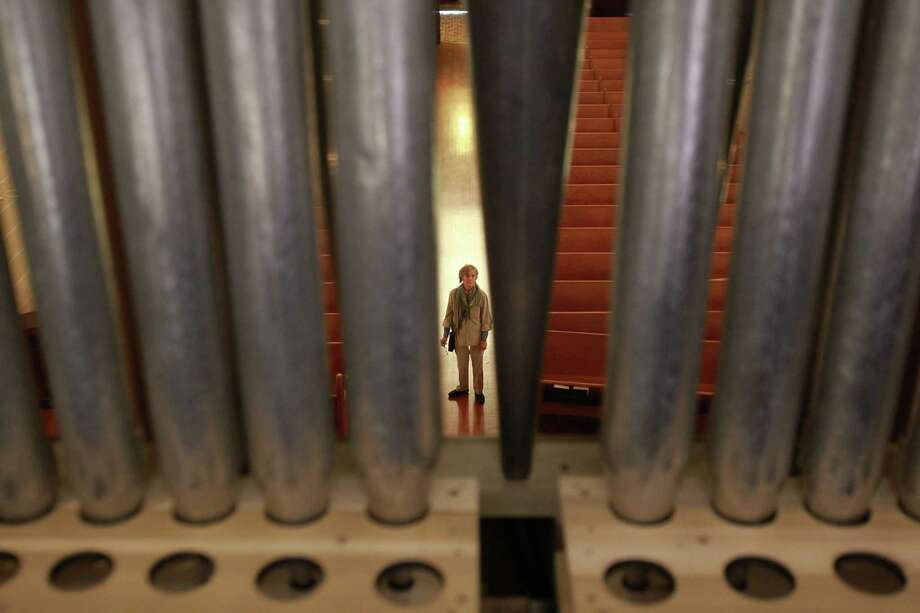 Dorry Shaddock views builders carry and set metal pipes into the pipe organ at First Evangelical Church on March 19, 2014, in Houston, Tx. Photo: Mayra Beltran, Houston Chronicle / © 2014 Houston Chronicle