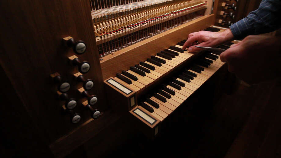 Martin Pasi listens to the new pipe organ after they have completed connecting trackers to pipes as part of the assembly process at First Evangelical Church on March 19, 2014, in Houston, Tx. Photo: Mayra Beltran, Houston Chronicle / © 2014 Houston Chronicle