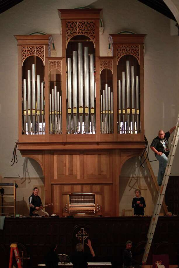 The Pasi Organ Builders work with lighting technicians to illuminate the new pipe organ correctly at First Evangelical Church on March 19, 2014, in Houston, Tx. Photo: Mayra Beltran, Houston Chronicle / © 2014 Houston Chronicle