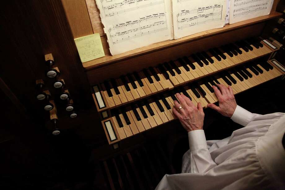 Organist Dorry Shaddock plays the new pipe organ during service at First Evangelical Lutheran Church in downtown on April 13, 2014, in Houston, Tx. Photo: Mayra Beltran, Houston Chronicle / © 2014 Houston Chronicle