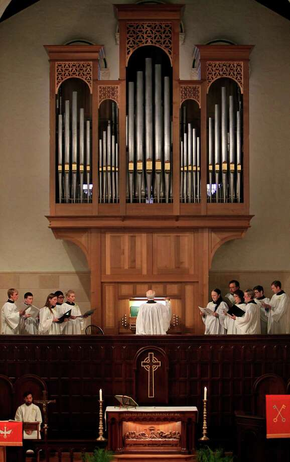 The choir sings along with the new pipe organ during service at First Evangelical Lutheran Church in downtown on April 13, 2014, in Houston, Tx. Photo: Mayra Beltran, Houston Chronicle / © 2014 Houston Chronicle