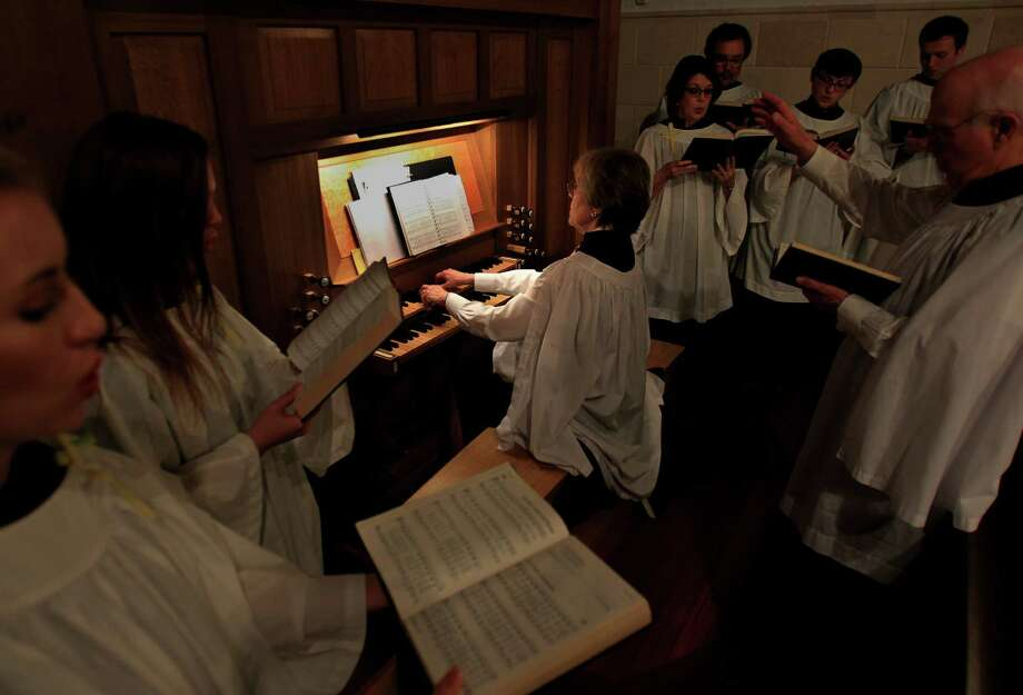 Organist Dorry Shaddock plays the new pipe organ as the choir members sing along at First Evangelical Lutheran Church in downtown on April 13, 2014, in Houston, Tx. Photo: Mayra Beltran, Houston Chronicle / © 2014 Houston Chronicle