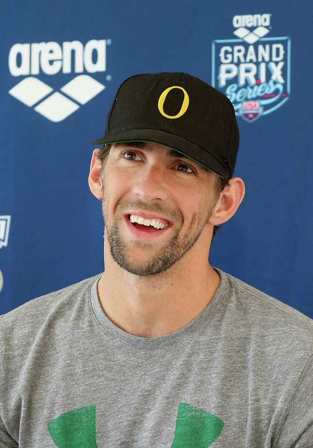 MESA, AZ - APRIL 24:  Michael Phelps speaks at a press conference after competing in the Men's 100m Butterfly Prelim during day one of the Arena Grand Prix at the Skyline Aquatic Center on April 24, 2014 in Mesa, Arizona.  (Photo by Christian Petersen/Getty Images) ORG XMIT: 459184977 Photo: Christian Petersen / 2014 Getty Images