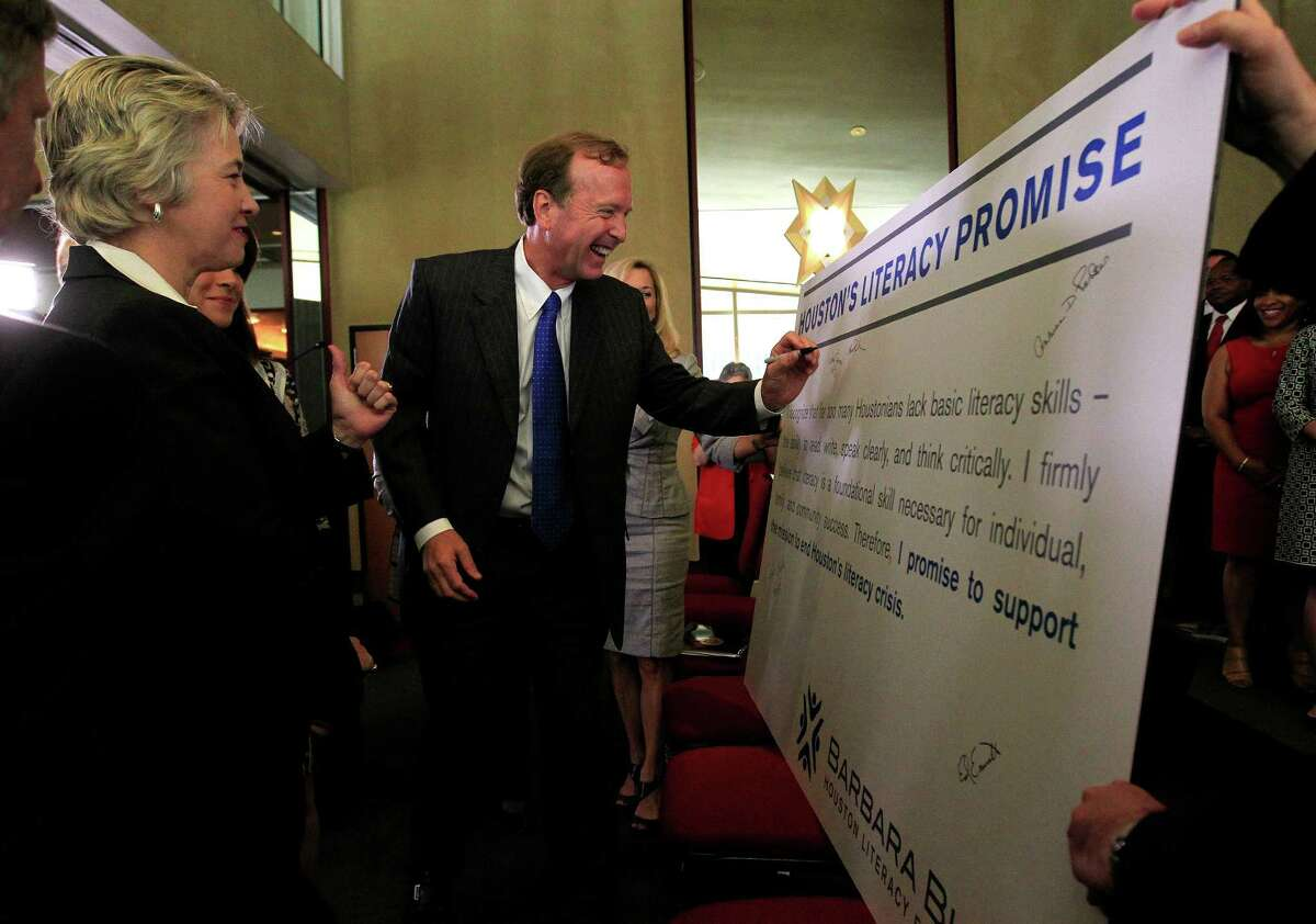 Neil Bush, with Mayor Annise Parker on Thursday, is chairman of the literacy foundation, which is calling for an expansion of pre-kindergarten classes and adult reading programs.