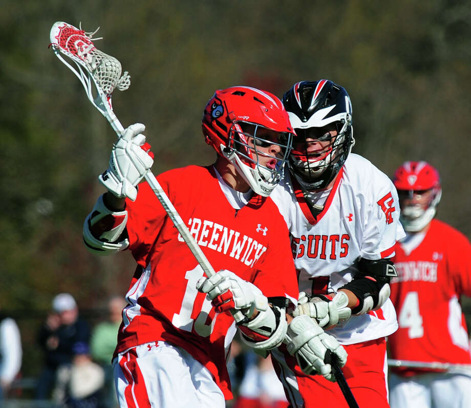 Fairfield Prep's Logan Ryan tries to block Greenwich's Will Perry as he carries the ball, during boys lacrosse action at Fairfield University in Fairfield, Conn. on Thursday April 24, 2014. Photo: Christian Abraham / Connecticut Post