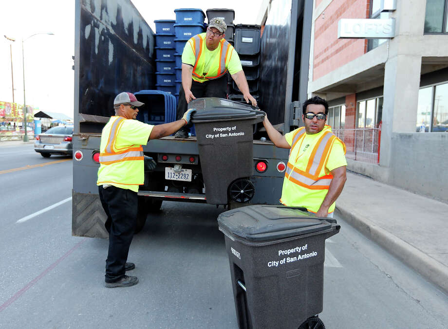 18 tons of recycled materialpicked up from 2013's Battle of Flowers and Flambeau Parades (this year's numbers not yet available). Photo: San Antonio Express-News / © 2014 San Antonio Express-News