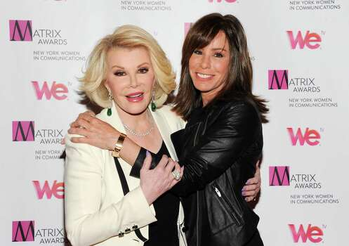 "FILE - In this April 22, 2013 file photo, Television personalities Joan Rivers, left, and daughter Melissa Rivers attend the 2013 Matrix New York Women in Communications Awards at the Waldorf-Astoria Hotel, in New York. Attorneys for two women held in a Cleveland home and abused for a decade say Joan Rivers should apologize for comparing living in her daughter's guest room with the captivity they experienced. Rivers and her daughter were discussing their reality show Tuesday, April 22, 2014, on NBC's ""Today"" show when she complained about her living arrangements, saying, ""Those women in the basement in Cleveland had more space."" (Photo by Evan Agostini/Invision/AP, file) ORG XMIT: CAET355 Photo: Evan Agostini / Invision"