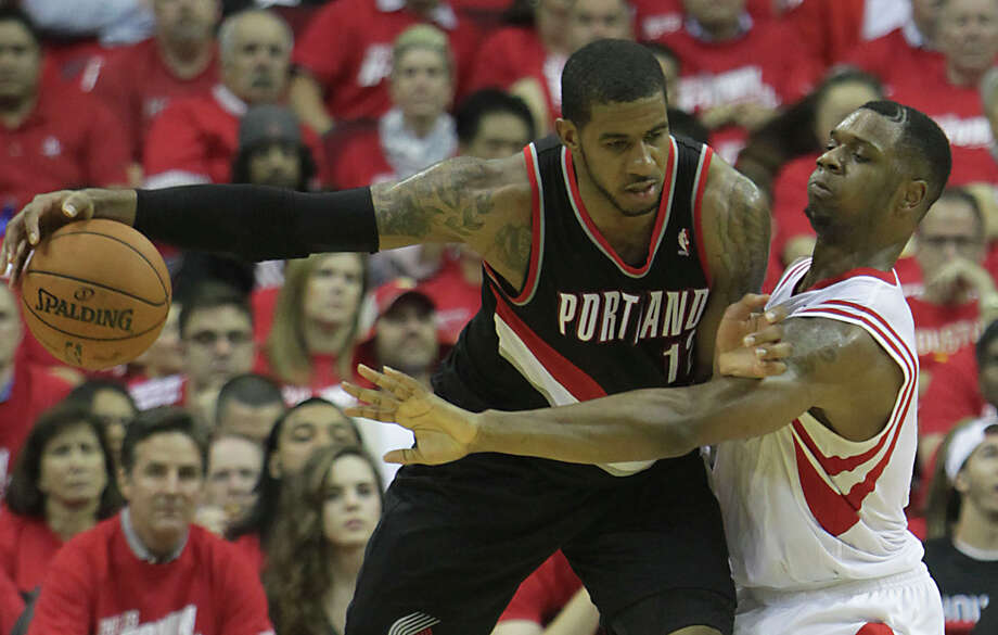 Experts say Rockets players like Terrence Jones, right, should lavish praise on LaMarcus Aldridge to mess with the mind of the Trail Blazers forward. Photo: James Nielsen, Staff / © 2014  Houston Chronicle