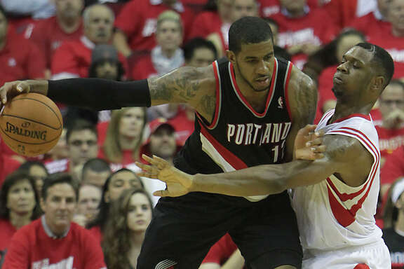 Experts say Rockets players like Terrence Jones, right, should lavish praise on LaMarcus Aldridge to mess with the mind of the Trail Blazers forward.