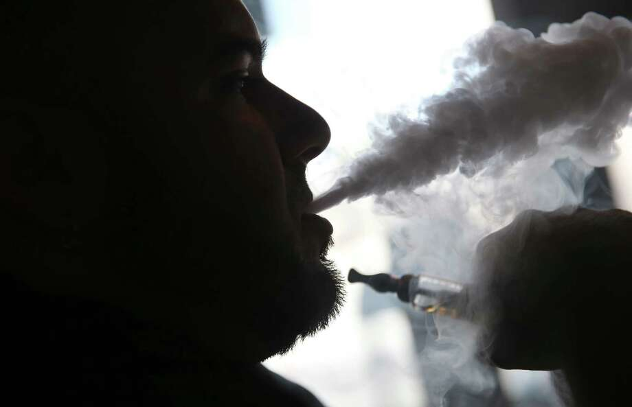 Some public health experts think e-cigarettes, which heat a nicotine solution to produce an odorless vapor without the smoke and tar of burning tobacco, may be able to help smokers quit. Photo: Joe Raedle / Getty Images / 2014 Getty Images