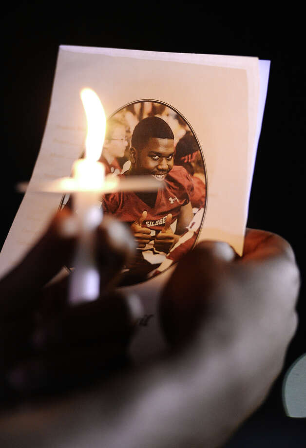 A program for Thursday night's memorial is illuminated by a candle during the vigil. A memorial service and candlelight vigil was held for Jamarcus Myers at the Silsbee High School football stadium on Thursday night. Photo taken Thursday, 4/24/14 Jake Daniels/@JakeD_in_SETX Photo: Jake Daniels / ©2014 The Beaumont Enterprise/Jake Daniels