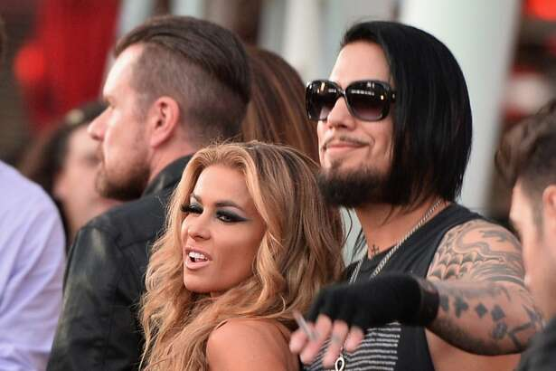 Model Carmen Electra (L) and guitarist Dave Navarro attends the 6th Annual Revolver Golden Gods Award Show at Club Nokia on April 23, 2014 in Los Angeles, California.
