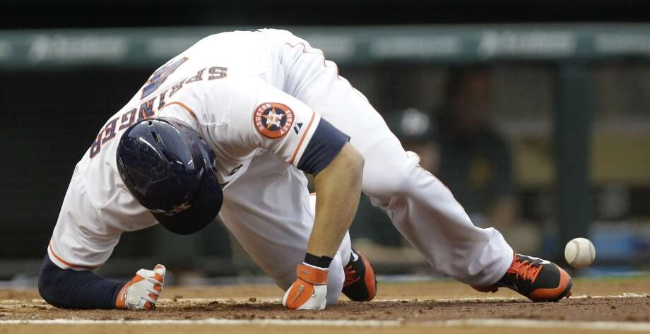 George Springer is hit by a pitch. Photo: Melissa Phillip, Houston Chronicle