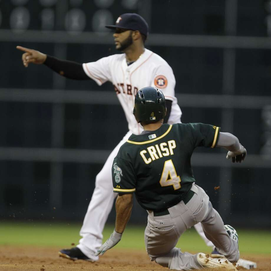 Coco Crisp slides safely ahead of Jonathan Villar at second after a throwing error by George Springer. Photo: Melissa Phillip, Houston Chronicle