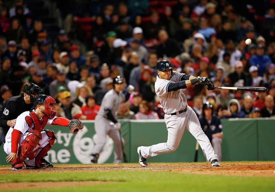 BOSTON, MA - APRIL 24: Yangervis Solarte #26 of the New York Yankees hits a two-run single in the 7th inning against the Boston Red Sox during the game at Fenway Park on April 24, 2014 in Boston, Massachusetts.  (Photo by Jared Wickerham/Getty Images) ORG XMIT: 477580429 Photo: Jared Wickerham / 2014 Getty Images