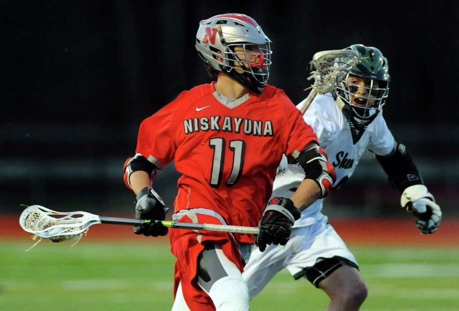 Niskayuna's John Pendergast, left, carries the ball as Shen's Pete Sacks defends during their lacrosse game on Thursday, April 24, 2014, at Shenendehowa High in Clifton Park, N.Y. (Cindy Schultz / Times Union) Photo: Cindy Schultz / 00026551A