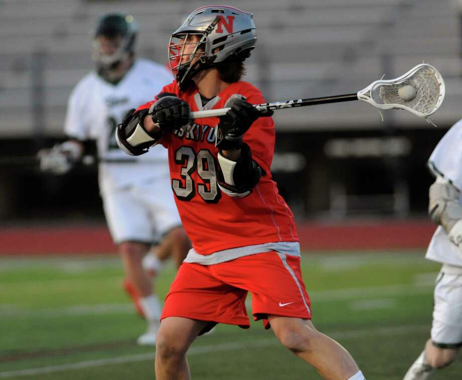 Niskayuna's Mike D'Amario, center, looks to pass during their lacrosse game against Shen on Thursday, April 24, 2014, at Shenendehowa High in Clifton Park, N.Y. (Cindy Schultz / Times Union) Photo: Cindy Schultz / 00026551A