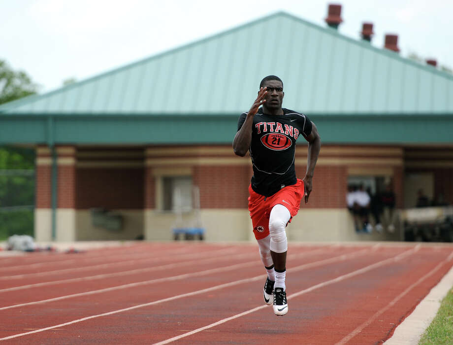 Corey Dauphine does a 300 meter practice run at the Memorial High School track Wednesday afternoon. Dauphine, a junior at Memorial High School in Port Arthur, competes in the 200 meter dash and on the relay team.