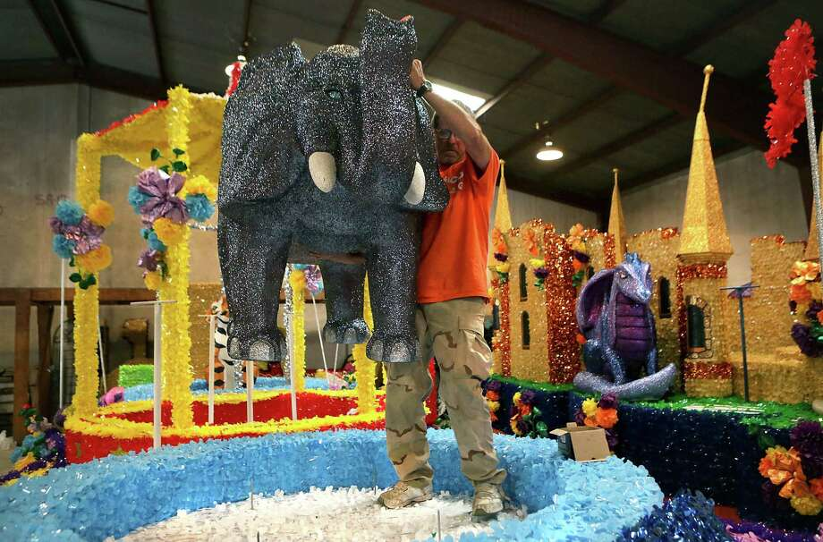 Lone Star Parade Floats owner Clyde Watts secures an elephant to one of the floats. Photo: Photos By Bob Owen / San Antonio Express-News / © 2012 San Antonio Express-News