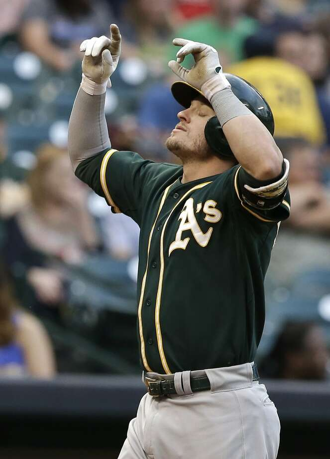 The A's Josh Donaldson had his first two-homer game, hitting one in the first (above) and another in the seventh. Photo: Pat Sullivan, Associated Press