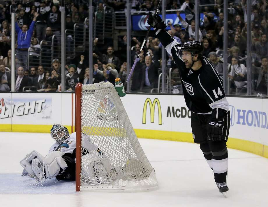 The Kings' Justin Williams celebrates behind Sharks goalie Antti Niemi after the second of his two goals in the second period. Photo: Chris Carlson, Associated Press