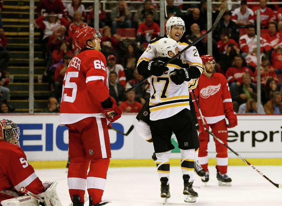 Milan Lucic (17) and Dougie Hamilton embrace after Jarome Iginla's game-winning overtime goal against the Red Wings on Thursday. Boston won 3-2 and can clinch the series Saturday. Photo: Gregory Shamus / Getty Images / 2014 Getty Images