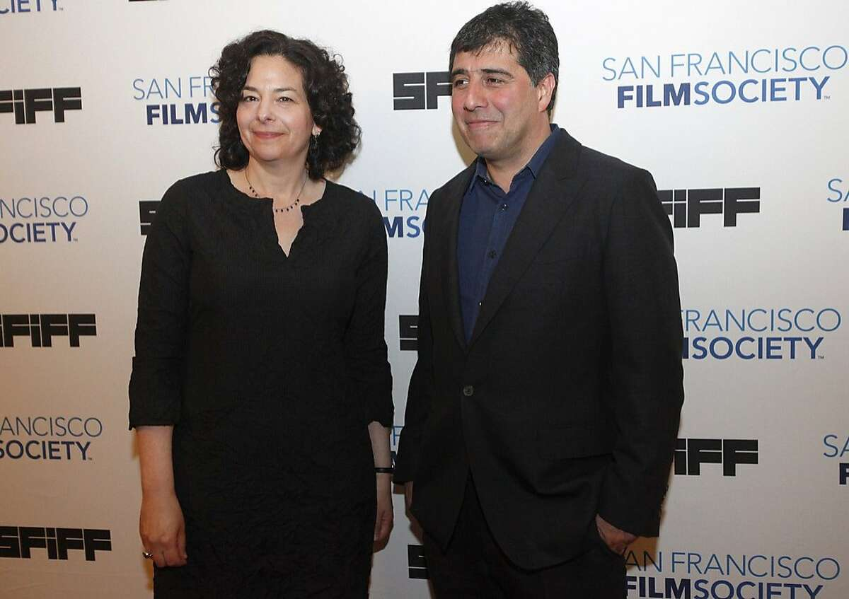 Rachel Rosen, Director of Programming at the San Francisco Film Society, left, and Hossein Amini, Director of the opening night film, The Two Faces of January, pose for photos on the red carpet during the opening night of the San Francisco International Film Festival April 24, 2014 at the Castro Theatre in San Francisco, Calif.