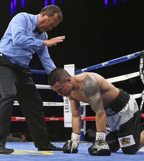 Referee Rafael Ramos starts the 10-count on Raul Martinez after he was knocked down by Sergio Perales (not pictured) in the 10th round of their junior featherweight bout last week. Photo: Edward A. Ornelas / San Antonio Express-News / ©2014 San Antonio Express-News